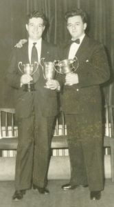 John Davies and Maurice Duffin with their silver-ware in 1958