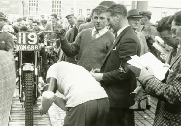 Arthur lampkin gets his 250 BSA 'weighed in' at the 1961 SSDT. Tommy Robertson is on second right examining paperwork