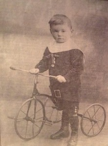 Wheels from an early age! - Tommy Milton with a tricycle around 1919