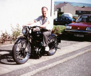 Tommy at home on his vintage AJS in the 1980's, the bike still owned by his son Ian.
